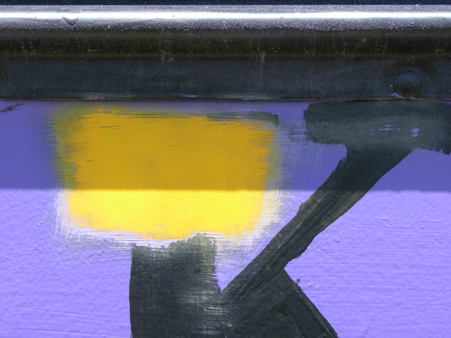Purple house paint stripped from schoolbus, closeup