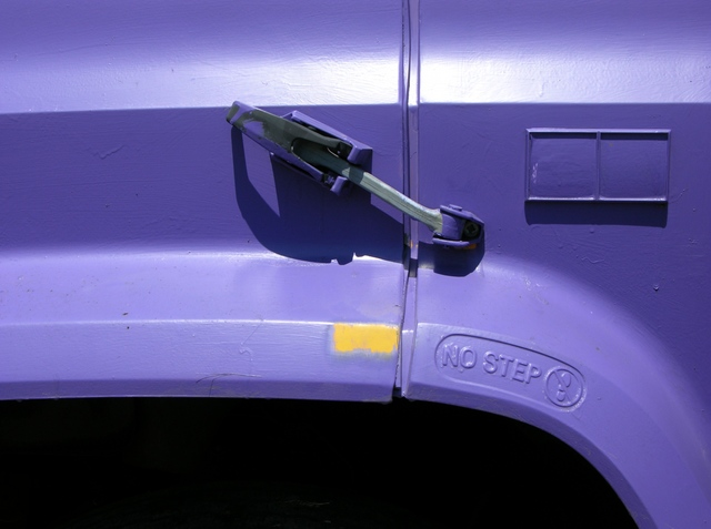 Purple house paint stripped from schoolbus fender