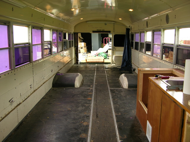 Rearward view of schoolbus interior, back door open