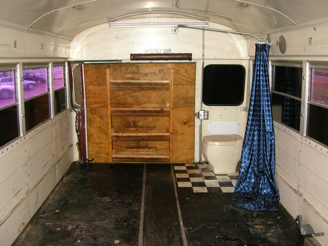 Rear interior of schoolbus, back door closed