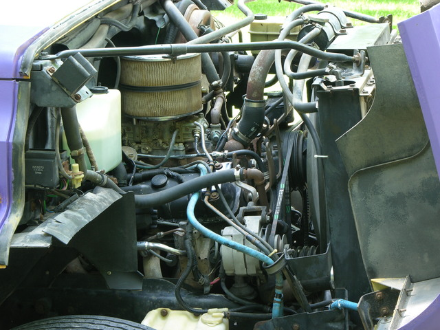 Bus engine compartment, passenger side, freshly washed