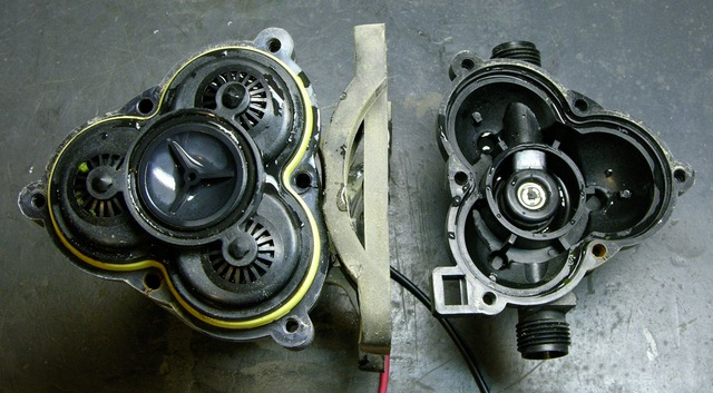 RV fresh water pump, top part of case removed