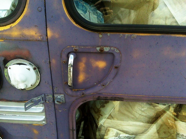 Rear door handle of junkyard Bluebird bus