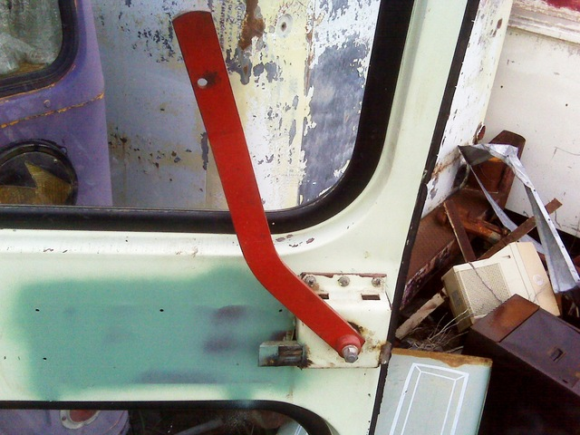 Interior rear door handle of junkyard Bluebird bus