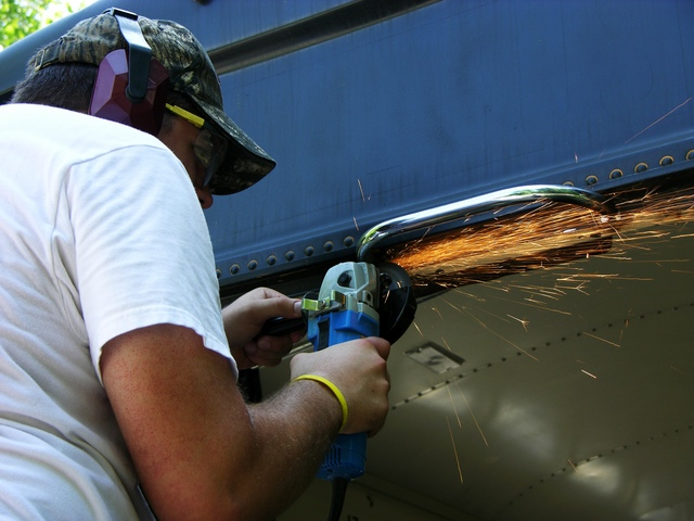 Jonathan cutting off handhold with angle grinder