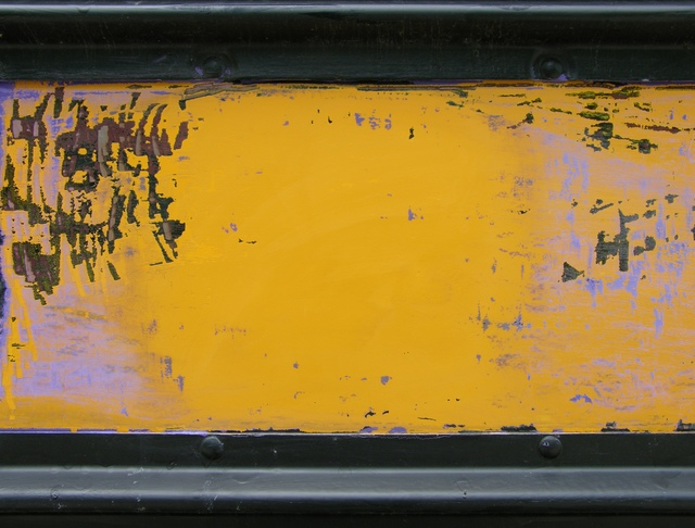 Stripping paint on a schoolbus