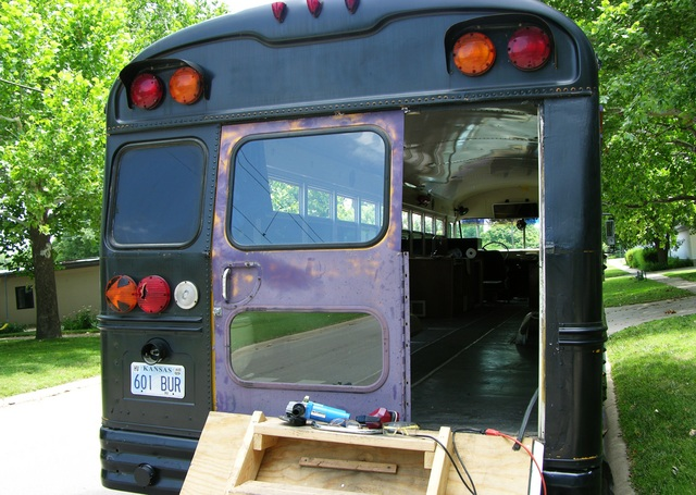 Schoolbus with salvage bus door fitted in place, rear corner view