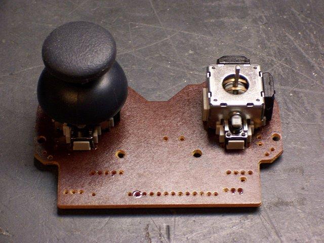 Game controller, joystick mounting