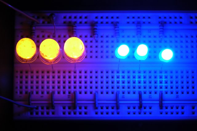10mm yellow and 5mm blue LEDs on breadboard, lit