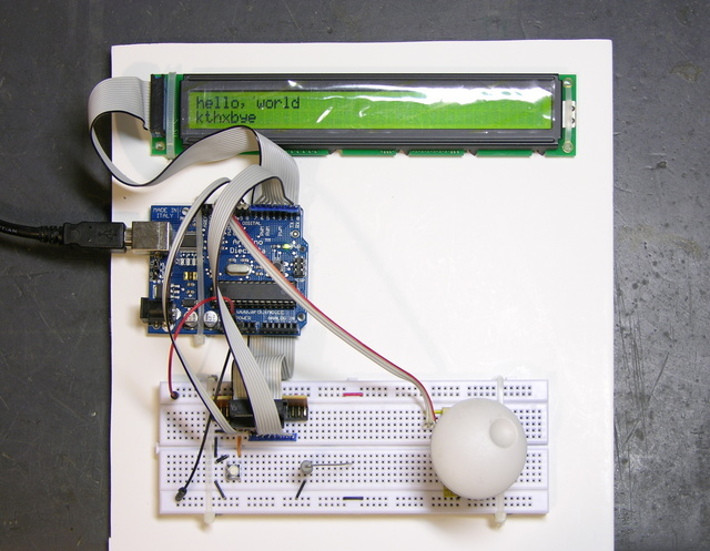 Arduino, LCD, and breadboard on foam-core sheet