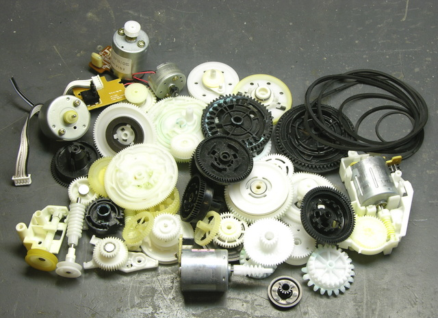 Pile of VCR gears, pulleys, belts, and motors