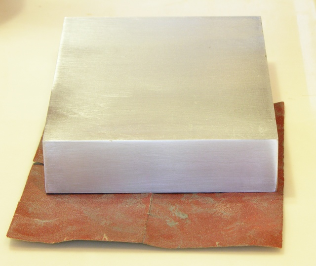 Aluminum block, face sanded with 180 grit