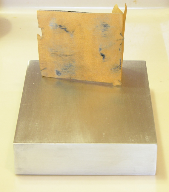 Aluminum block, face sanded with 220 grit