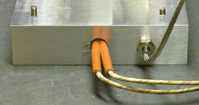 Aluminum block with heater element and thermocouple