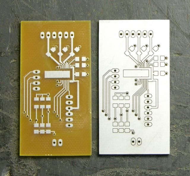 Two milled circuit boards, one peeled