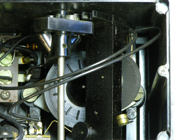 Variable transmission in electromechanical metronome, set for slow tempo