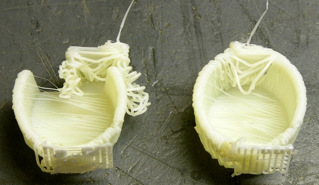 Fourth and fifth attempts to print cup in MakerBot CupCake, shown upright