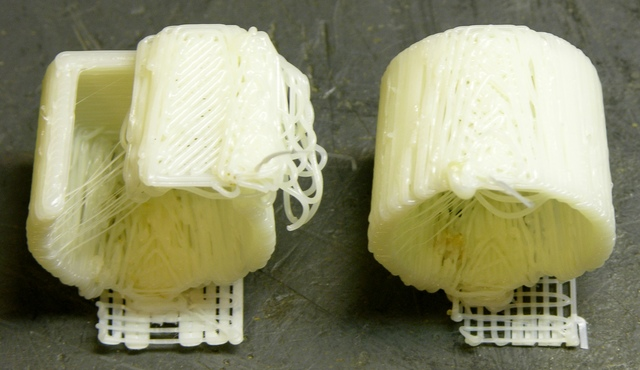 Fourth and fifth attempts to print cup in MakerBot CupCake, shown on side