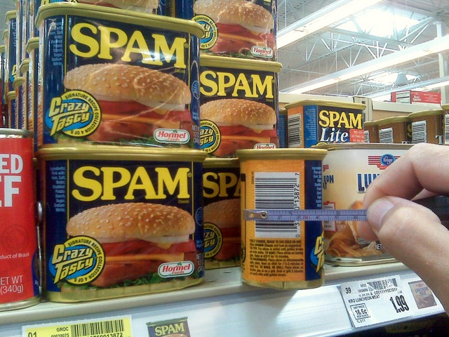 Measuring width of Spam can at grocery store
