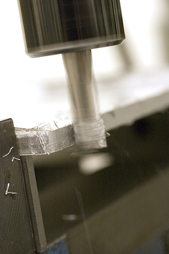 Chips flying while milling aluminum plate
