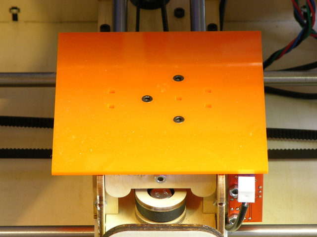 Orange acrylic sub-bed on MakerBot CupCake build stage