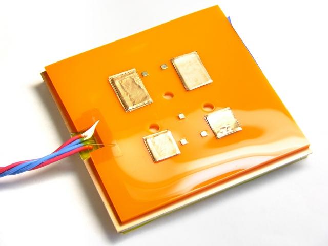 Copper tape on underside of MakerBot CupCake heated build platform