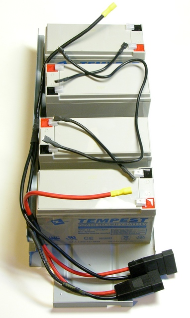 Liebert GXT2-2000RT120 UPS batteries laid out with loose wires