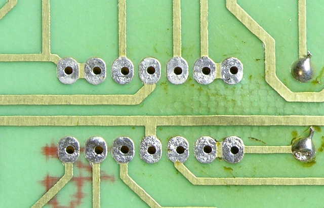 Circuit board after desoldering an IC with a hot air pencil and cleaning flux
