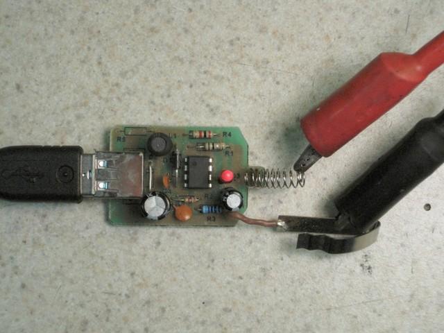 Automotive USB power adapter under load test