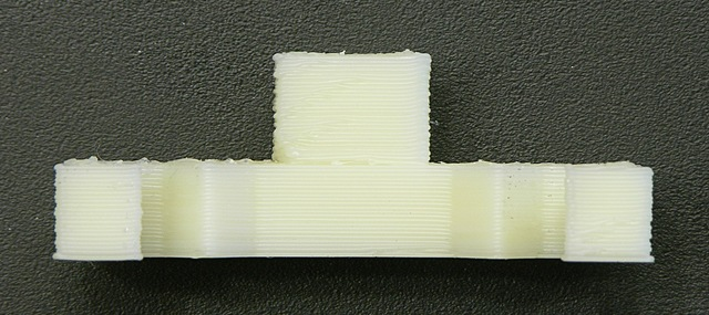 Cooling fan printed on MakerBot Cupcake, front-side closeup showing Z-axis wobble
