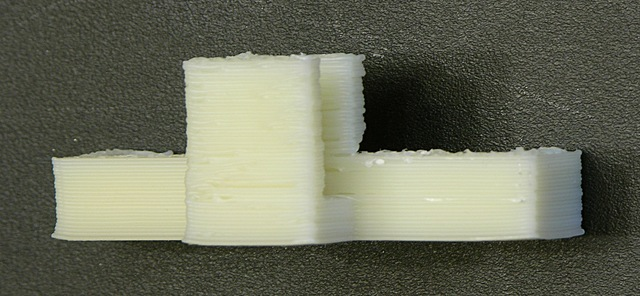 Cooling fan printed on MakerBot Cupcake, back-side closeup showing blobbing after non-contiguous perimeter