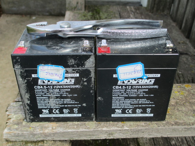 Two sealed lead-acid batteries from Razor E1