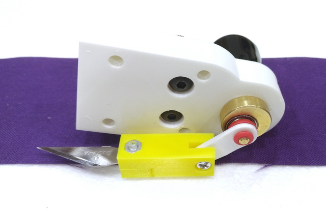 X-ACTO® blade holder attached to motor and cam in mount