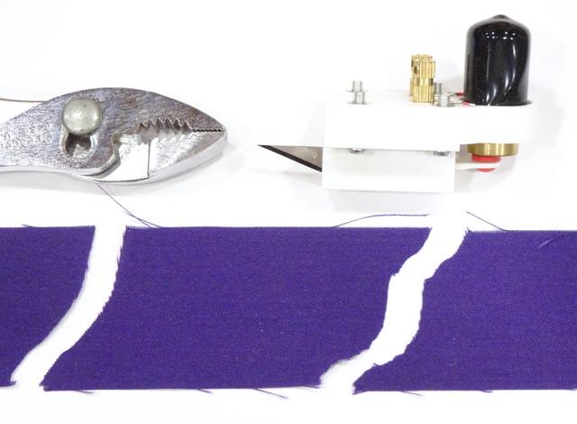 prototype reciprocating-blade cutterhead with cut fabric
