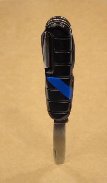 pocketknife stuck in cardboard